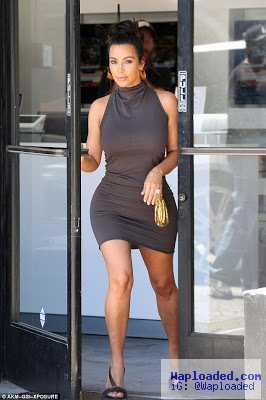 Kim Kardashian shows off her curvy body in a tight dress which displayed her bodyshaper